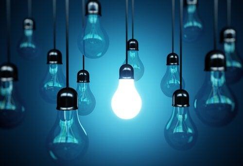 one lit lightbulb