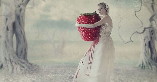 woman hugging giant strawberry