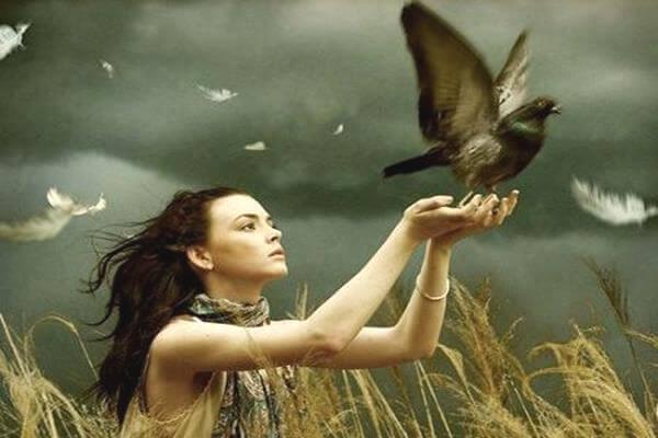 woman letting bird free