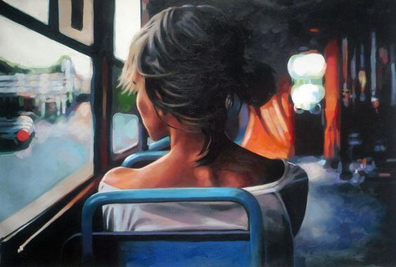 woman on bus looking out window