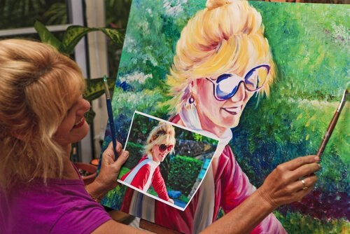 woman painting a happy painting