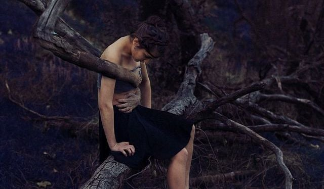 woman trapped by a tree
