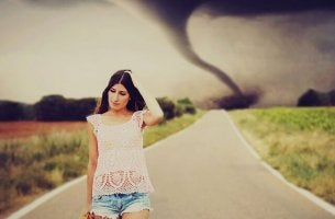 worried girl tornado in background