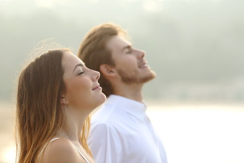 Man and Woman Breathing Deeply