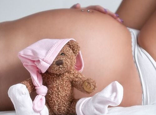 Pregnant Belly and Teddy Bear