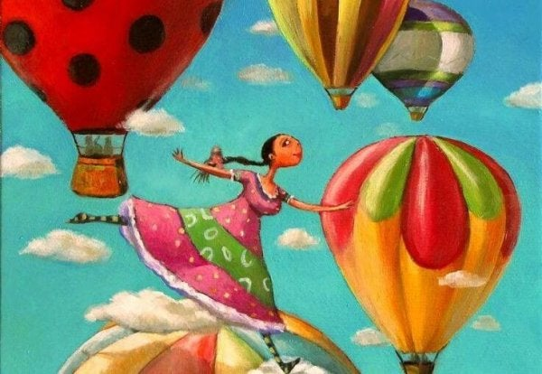 girl floating with hot air balloons