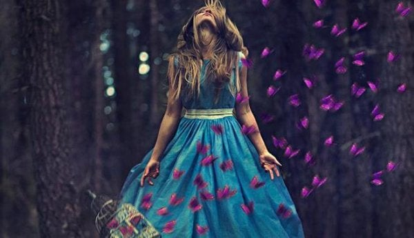 girl surrounded by purple butterflies