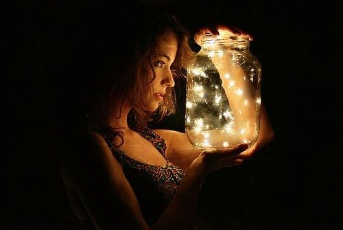 Woman with Jar of Fireflies