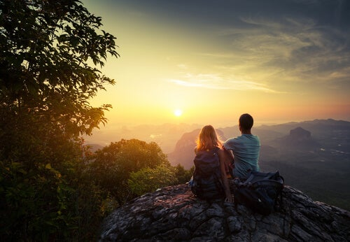 two people on a mountain