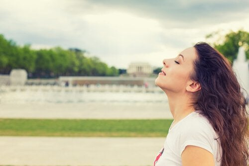 woman eyes closed enjoying breeze
