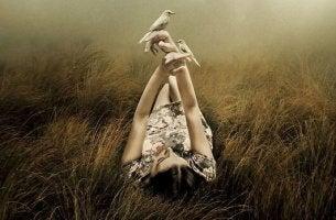 woman holding birds