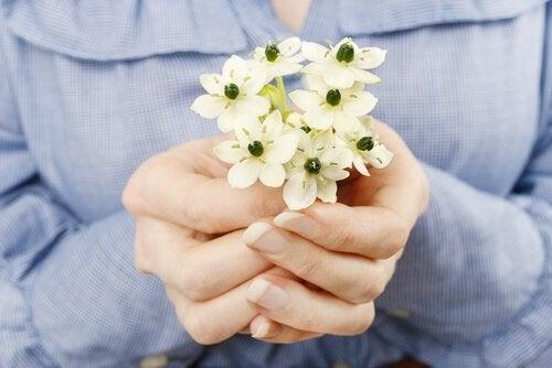 Hands Offering Flowers