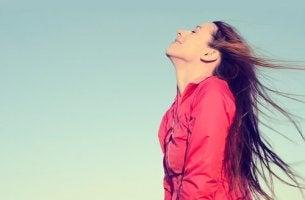 Happy Woman Breathing Deeply