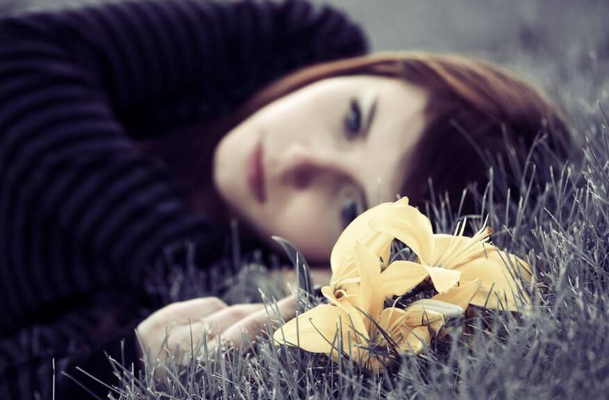 Sad Woman on Ground Yellow Flower