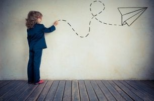 Child Drawing Paper Airplane on Wall