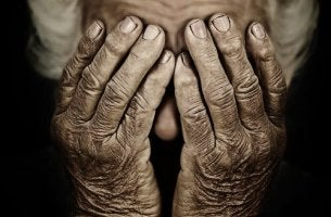 Old Hands Covering Face