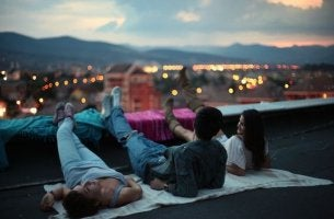 Friends on Roof at Night