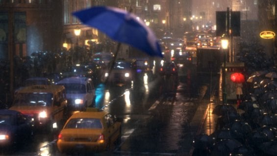 blue umbrella flying through city