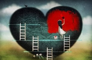 girl painting gray heart red