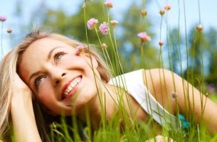 happy girl laying in grass and flowers
