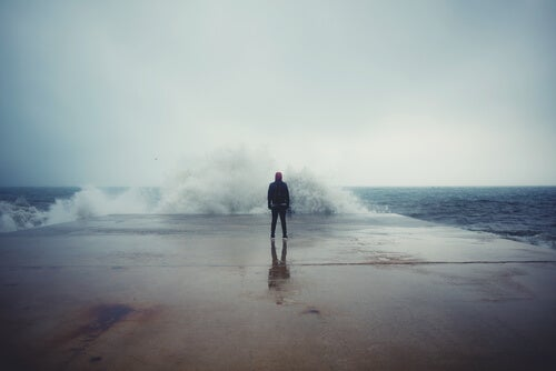man in front of a wave