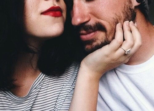 Woman Rubbing Man's Face