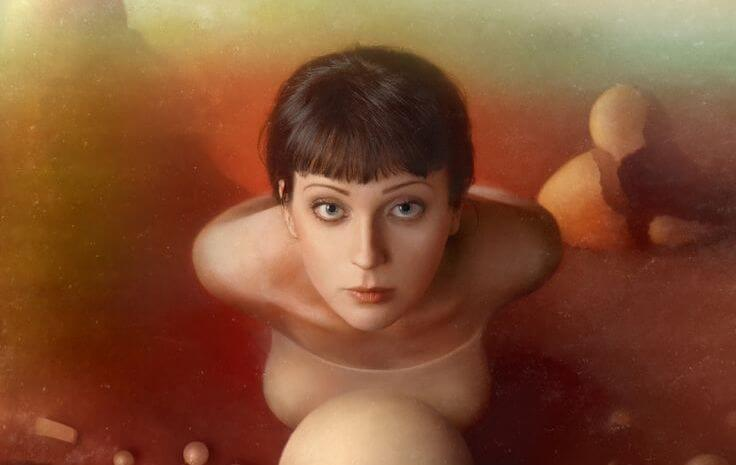 Woman in Front of Sphere