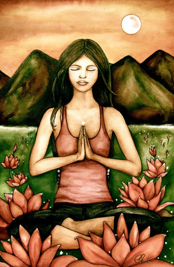 Woman Meditating before Mountains