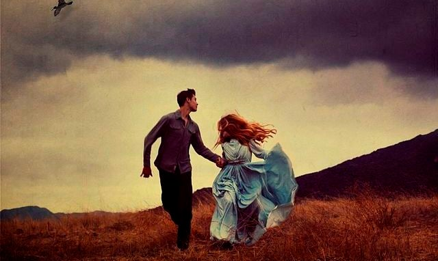 Man and Woman in Blue Dress Running