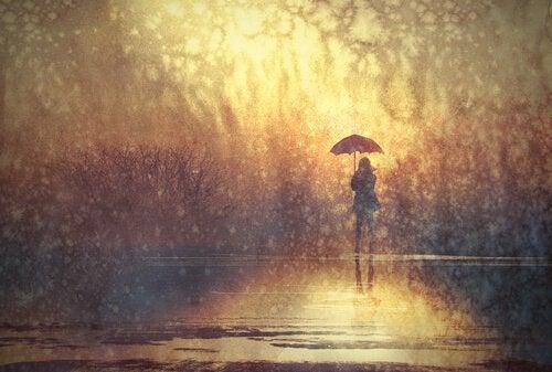 person alone in the rain