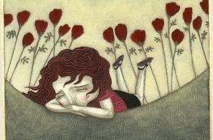 sad girl among flowers