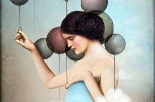 sad woman holding balloons
