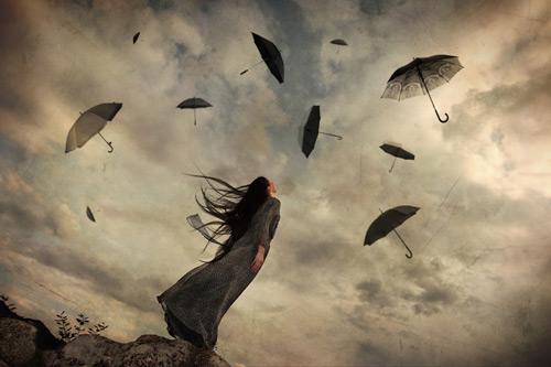 umbrellas flying away
