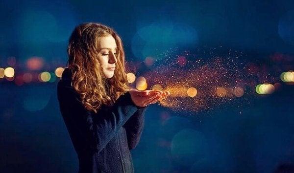 woman blowing dust