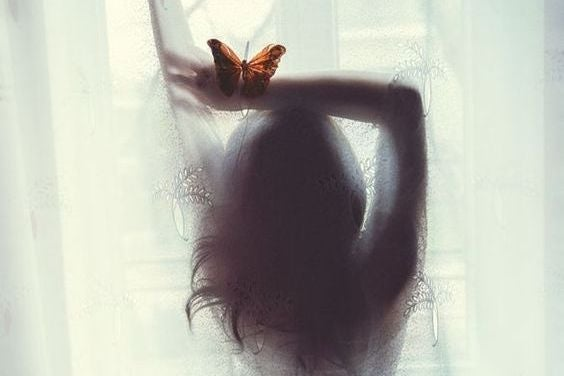 woman silhouette with butterfly