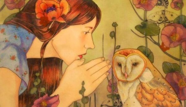 woman whispering to an owl