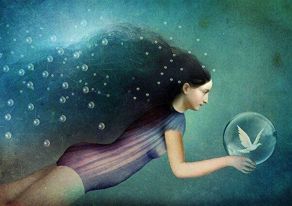 woman with bird in bubble underwater