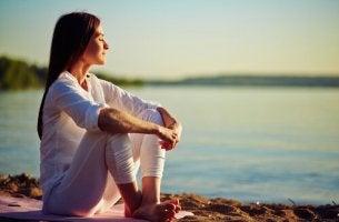 Woman Sitting Beside Sea