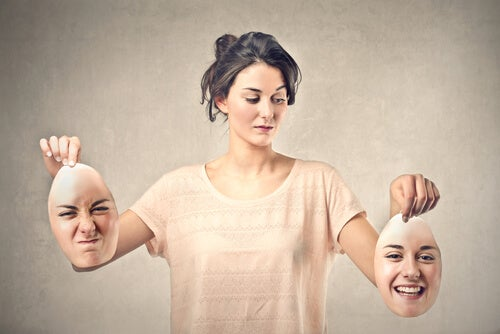 Woman Holding Happy and Angry Faces