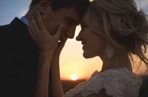 Couple Looking Into Eyes At Sunset