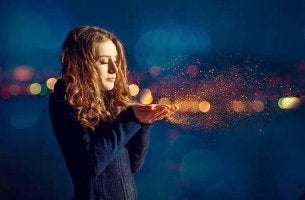 Woman with Glowing Powder in Hands