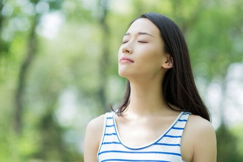 girl breathing with her eyes closed