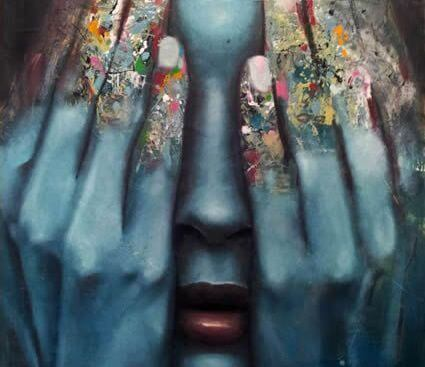 girl-covering-face-with-colorful-hands