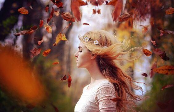 girl-in-fall-woods-wind-in-hair