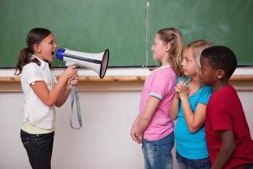 girl-with-megaphone-yelling-at-other-children