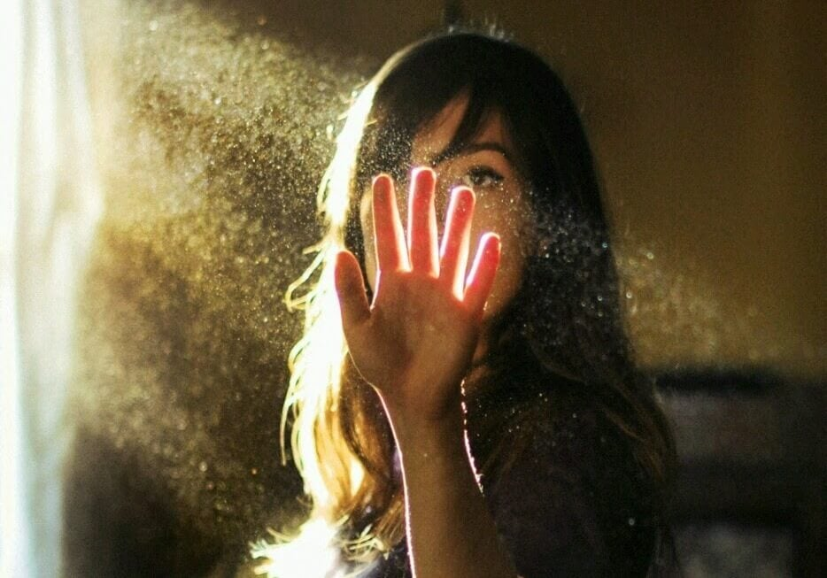 Woman Touching Beam of Light