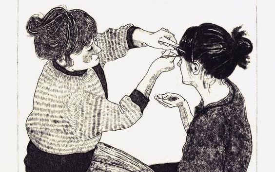 sisters combing hair
