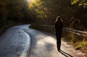 woman-walking-alone-down-a-road