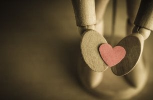 wooden-figure-holding-heart