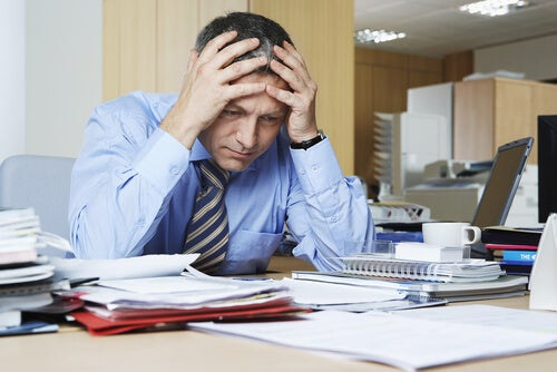man dealing with psychological exhaustion at work